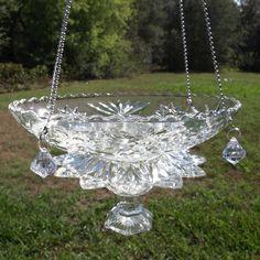 Repurposed glass hanging bird feeder.