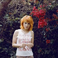 Hayley Williams of Paramore. She is known for her orange hair.