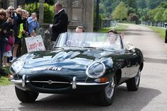 Bride Pippa Middleton and her new husband James Matthews cheer and wave as they leave the ...