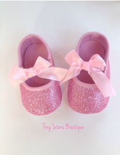 ** Pink Baby Shoes ** Very delicate glitter Pink shoes ideal for any special occasion!! Pink Glitter and pink trim with bow are the perfect way to add a little sparkle to your little ones outfit. Thes