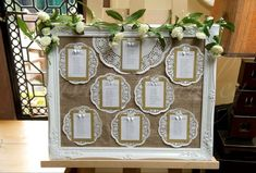White Shabby Chic Wedding Table Plan with Rose Garland & Bows Lined For Easel