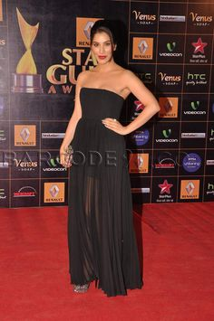 Sophie Choudry attends the Star Guild Award Red carpet events in a black sheer strapless gown.