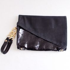 """Black Contrast Faux Leather Clutch Alexisuospny  ⌁ Measurements: 9.5"""" length 7"""" height 1.5"""" depth 6"""" strap drop  ⌁ Material: Synthetic materials  ⌁ Condition: Used. The inside lining is badly ripped & the suede on the back part is worn. However, the front still looks good!  Comment below if you have other questions. Please make all offers using the """"offer"""" button. No trades or PayPal. No holds (first come, first serve). Comes from a smoke-free/pet-free home. Not responsible for lost/damaged…"""