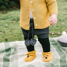 The mornings are starting to get chilly down here... keep them warm in lovely layers like the River cardigan made in a soft cotton and wool blend the Elfin Bloomers in 100% wool and the sweetest booties the hand knitted Bear Booties! All online and at stockists now  . . . . . . #acornkids #kidsfashion #knitwear #wool #cotton #cardigans #bloomers #booties #winterfashion #babyfashion #handknitted #handmade