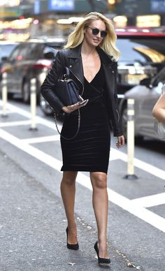 Candice Swanepoel in a leather jacket and velvet dress.