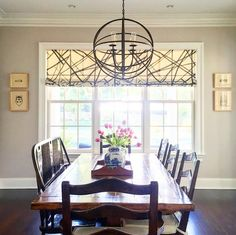 love the window fabric and light fixture!