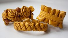 DIY upcycled bracelets made from an old purse.