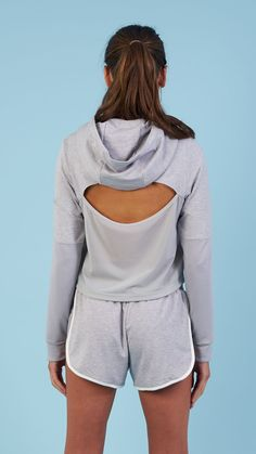 Designed with comfort in mind, featuring a slouch hood, crossover hem and cuffs, and unique cut-out back design. Coming soon in Light Grey Marl.