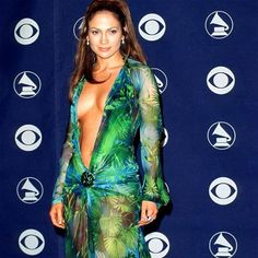 GRAMMY Style Through The Years; All Eyes On Me JLO made it a night to remember in 2000 when she sauntered onto the red carpet in this palm print Versace gown, complete with plunging neckline and super-high split commanding everyone's attention. Jlo Green Dress, Dress Up, Stunning Dresses, Beautiful Gowns, Jennifer Lopez Green Dress, Versace Gown, Red Carpet Gowns, Fashion Plates, Plunging Neckline