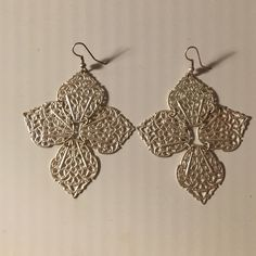 """Silver 4 Leaf Earrings Silver leaf or petal earrings. Each piece is attached to the one next to it so they move a little bit. Super fun to dress up an outfit, definite attention pieces. 2"""" x 2"""" Not sterling silver. Jewelry Earrings"""