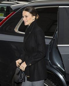 Princess Sofia of Sweden arrived in a blacked out car clutching a bamboo handled handbag. Her hair was neatly slicked back in a low bun. She paired her simple look with silver disc earrings and her wedding ring.