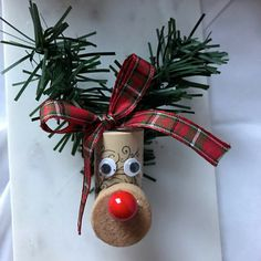 This adorable Reindeer ornament is made from up-cycled wine corks. Hang it on your tree, use as a stocking stuffer, table decoration, wine tag, etc. Contact me with any questions :)