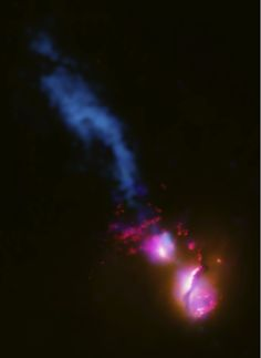 Black Hole Fires at Neighbor This composite image shows the jet from a black hole at the center of a galaxy striking the edge of another galaxy, the first time such an interaction has been found. In the image, data from several wavelengths have been combined.