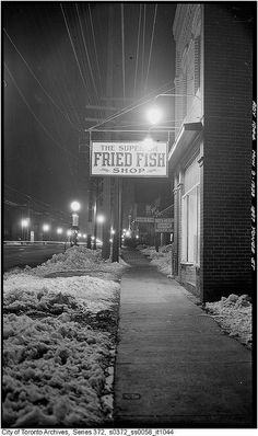 The view of 1887 Yonge Street, Toronto (with illuminated signs) at night, March 9, 1923.