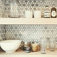 #tile #backsplash as backdrop to nicely styled #openshelving, discovered during a recent trip down the Instagram rabbit hole / via @susanyeleyinteriors / #tiletuesday #interior #interiors #interiordesign #tiles #tiled #tilework #tiling #tilegeeks #kitchendesign # #backsplashideas #idcdesigners #hexalove #pattern #instadecor #homedecor #homedesign #kitchenremodel #ihavethisthingwithtiles #ihavethisthingwithwalls #tileaddiction #tilelove #marble #walltiles