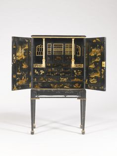 A Chinese Export and European painted Japanned, lacquered and gilt-decorated cabinet-on-stand late 18th century the top decorated with flowers, above two doors with pastoral scenes and lovers in a landscape, the interior of the doors decorated with chinoiserie scenes of figures, landscapes, junks and pagodas, and a gilt-decorated architectural interior, with pierced slides with fretwork, above twelve drawers some decorated with chinoiserie figures, landscapes Sotheby's