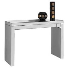 This chic and contemporary mirrored console table will provide an edge of sophistication that will surely be the focal point of any living space. The geometric inspired design offers bold clean lines while the mirrored effects adds a dramatic touch that will enhance any decor. Pair it with the matching coffee table and end table to bring your sense of style to a whole new level.