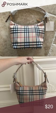 Tan plaid shoulder bag Tan plaid shoulder bag,  never been used, tag and plastic covering still protecting handle Bags Shoulder Bags