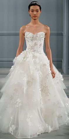 Monique Lhuillier Spring 2014: Ivory embroidered lace drop waist bodice gown with tiered tulle skirt.