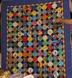 I Spy Quilt - with snowball block. I like the black and bright colored boarder.
