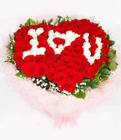 I♥U Style 99 roses by red and white color with gardenia leaves heart shaped bouquet.