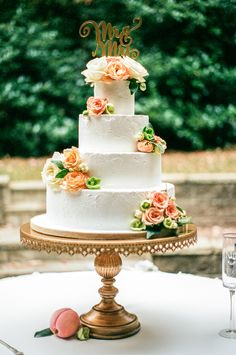 """Peach and cream roses, four tier wedding cake, gold """"Mrs. and Mr."""" cake topper // Alisha Crossley Photography"""