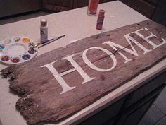 """""""Home"""" sign on old wood"""
