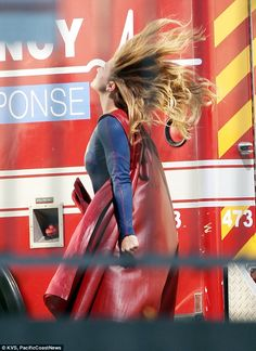 This scarlet Supergirl cape looks to have a leather-like sheen. You also get a glimpse of the cape's lining. From DailyMail.