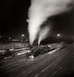 """""""Freight train about to leave the Atchison, Topeka & Santa Fe Railroad yard for the West Coast.""""  - Argentine, Kansas (March 1943)"""