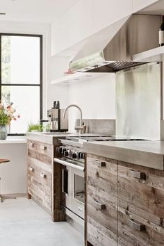 Rustic wood cabinets, nice stove - Would love it if my kitchen looked like this.