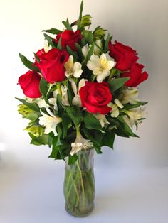 Valentine Flower Arrangement.  Holiday Roses.  Red, white and green flowers.