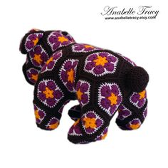 Ready to ship!  Need a gift for someone special? Why not give her flowers and her favorite animal stuffed toy in one!  Meet Max the bulldog. This bulldog is one of a kind and absolutely adorable doll. He is created by sewing 58 pieces of flower patches. He is made of premium acrylic yarn. Stuffed with polyester filling and has safety eyes.  Max is approximately 14 inches long and 8.5 inches tall.  This product is made in a smoke-free and pet-free environment.