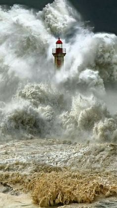 Massive waves engulfs a lighthouse. I look at these images, and I can't fathom the what the person is feeling, the one IN the lighthouse, even the photographer. Fuerza Natural, Cool Pictures, Cool Photos, Amazing Nature Photos, Powerful Pictures, Lighthouse Pictures, Beacon Of Light, Ocean Waves, Belle Photo