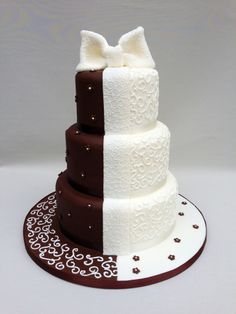 Half chocolate and half icing cake decorated with an iced bow.