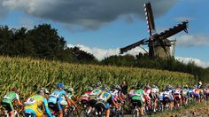 The peloton rides past a windmill during the Elite Women's Road Race on day seven of the UCI Road World Championships in Valkenburg, Netherlands.
