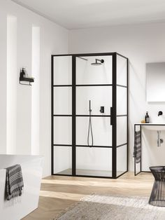 All Soho screen options are in height and come with easy clean safety glass. The matte-black steel framing is only to the exterior of the glass, therefore allowing easy cleaning to the interior glass without any physical barriers. White Bathroom, Bathroom Interior, Modern Bathroom, Small Bathroom, Soho, Modern Shower, Bathroom Toilets, Shower Enclosure, Lofts