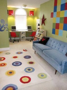 HGTV fanhennesses added a colorful detail to every inch of space in this boys' playroom. Geometric murals, colorful sconces and a vibrant area rug bounce off the sunny lime walls for a creative use of primary hues.