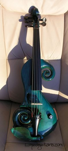 Violin in beautiful turquoise green shell swirls. A MOST POPULAR RE-PIN for this aptly named model series Liquid Violin. RESEARCH #DdO:) - https://www.pinterest.com/DianaDeeOsborne/instruments-for-joy/ - INSTRUMENTS FOR JOY - Company motto: Revolutionizing  electric violins  through 3D technology. Handmade by Brandon MacDougall. Fourteen inch, 4/4 size maple & ebony Professional level Instrument, five strings. Used one on eBay for $305 in 2015.