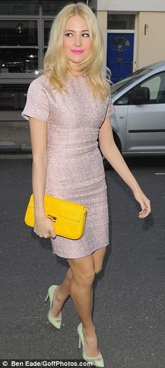 Splash of colour: The singer added a yellow clutch bag and mint heels to complete her outfit