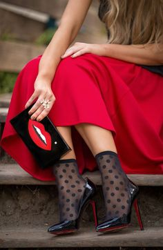 Long red skirt, black sheer polka dots socks, black heels
