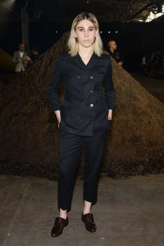 Pin for Later: These Stars Have Been Sitting Pretty in NYFW's Front Row Zosia Mamet Zosia Mamet went with a loose black suit set, which she paired with slip-on loafers.
