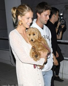 Puppy love:Patrick Schwarzenegger, his girlfriend Abby Champion, and her adorable mini-Goldendoodle were spotted arriving to celeb-favorite Hillsong Church on Wednesday