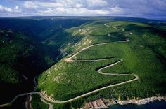 The Cabot Trail passing through the Highlands National Park in Cape Breton, Nova Scotia Cabot Trail, Cape Breton, Nova Scotia, Places To Travel, Places To Visit, Voyager Loin, Atlantic Canada, Canada Travel, Vacation Spots