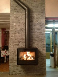 A central fireplace can heat a large area.