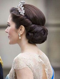 beautiful updo - but might look weird without the tiara.