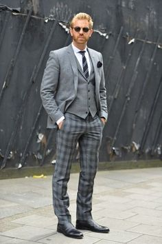 Go for a classic style in a grey wool blazer and grey plaid wool trousers. If you don't want to go all out formal, go for a pair of black leather chelsea boots.  Shop this look for $289:  http://lookastic.com/men/looks/dress-shirt-tie-pocket-square-blazer-waistcoat-dress-pants-chelsea-boots/4985  — White Dress Shirt  — Charcoal Vertical Striped Tie  — Black Pocket Square  — Grey Wool Blazer  — Grey Waistcoat  — Grey Plaid Wool Dress Pants  — Black Leather Chelsea Boots