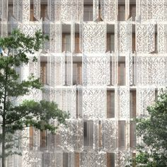 The perforated steel façade of Piercy Conner Architects' Restello apartment building provides natural ventilation and shade; image © Piercy Conner Architects