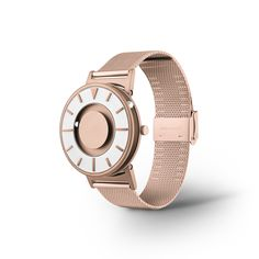 The watch has a case and unique, minimal aesthetic. Instead of a conventional dial, the Bradley Mesh features a magnet that rotates two ball bearings around the watch face and polished rose-gold markers. Armband Rosegold, Gold Armband, Sport Watches, Watches For Men, Dezeen Watch Store, Rose Gold Watches, Steel Mesh, Classic Gold, Accessories