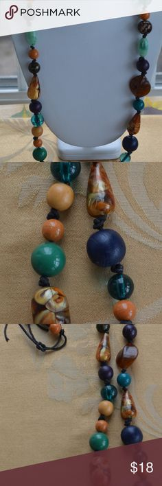 "Multi-colored Wooden, Plastic Beaded Necklace Pretty and colorful is this wooden and plastic beaded necklace.  The beads are strung on cord; the necklace ties and measures 30"" in length.  The necklace is in very good vintage condition.  This necklace has a very pretty combination of colors and will be a nice addition to your jewelry collection! Jewelry Necklaces"