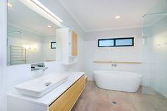 Green Homes Australia - Your Trusted Green Home Builder Green House Design, Green Homes, Energy Efficient Homes, Australian Homes, News Design, Home Builders, Corner Bathtub, Range, Bathroom